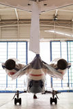 Private corporate jet parked in a hangar Stock Image