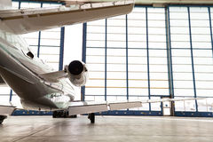 Private corporate jet parked in a hangar Royalty Free Stock Photos