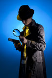 Private Detective. Searching for information, isolated on a blue background royalty free stock photography