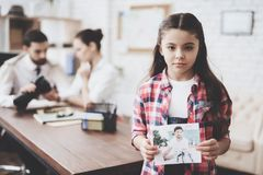 Private detective agency. Girl is posing with photo while man is showing clients photos on camera. Private detective agency. Girl in shirt is posing with photo royalty free stock photos