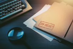 Private detective desk with envelopes labeled as confidential royalty free stock images