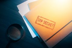Private detective desk with envelopes labeled as top secret stock image