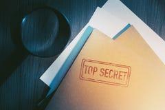 Private detective desk with envelopes labeled as top secret. Private investigator desk with top secret envelopes stock photo