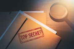 Private detective desk with envelopes labeled as top secret royalty free stock images