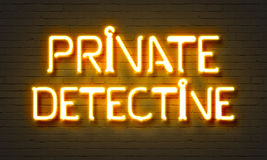 Private detective neon sign on brick wall background. Private detective neon sign on brick wall background Royalty Free Stock Images