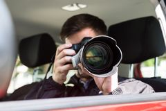 Private Detective Photographing With Slr Camera royalty free stock image