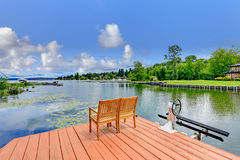 Private dock with chairs Stock Image