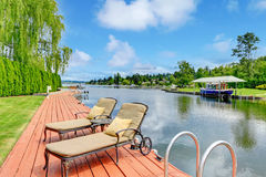 Private dock with deck chairs Royalty Free Stock Photos