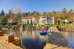 Private dock with jet ski lifts and covered boat lift, Lake Washington. Stock Photo