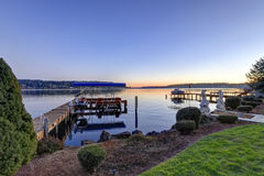 Private dock with jet ski lifts and covered boat lift, Lake Washington. Stock Image