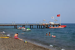 Private dock for motorboats on gravel beach Turkish Mediterranea Royalty Free Stock Photos