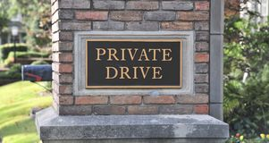 Private Drive Sign. A private drive sign in a affluent area of a metropolitan neighborhood Stock Photos