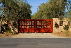 Private driveway with a big red gates. At sunset Royalty Free Stock Photos