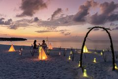 Private event dinner for a honey moon couple in the Maldives islands royalty free stock photos
