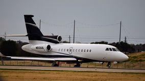 A Private Falcon 900EX Landing stock image