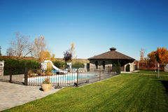 Private Fenced Pool. Small, private, fenced pool and bath house in a residential setting Stock Image