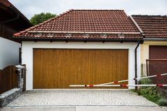 Private garage with barrier, wooden gate. Secure Stock Photography