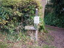 Private garden no parking sign on wooden post outside country royalty free stock image