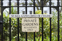 Private Gardens Sign. Outlawing ball games, dogs and cycles Royalty Free Stock Images