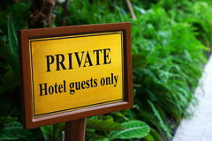 Private guests only sign. A private sign that reads for hotel guests only Royalty Free Stock Image