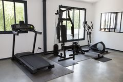 Private gym at home interior with different sport exercise equipment. A Private gym at home interior with different sport exercise equipment stock images
