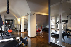 Private gym in a home. Private gym with modern equipment in  the home Royalty Free Stock Photography