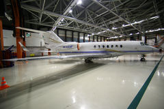 Private Hawker Beechcraft 4000 M-KENF standing in a hangar at Sheremetyevo international airport. Royalty Free Stock Images