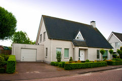 Private home. Facade with drive and garage Stock Image