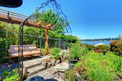 Private home Garden near the lake. Royalty Free Stock Photos