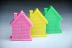 Private house. Three coloured toy- houses.The still life Stock Images