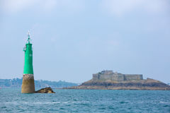 Private house and green lighthouse in the bay of Saint-Malo Royalty Free Stock Photos