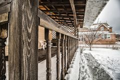 Private house terrace. Terrace of a private rural wooden house in winter royalty free stock photography
