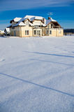 Private house in winter. Outdoor photo of a private real estate house in winter on sunny day with pure white snow royalty free stock photos