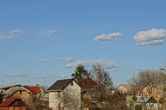 Private houses and sky with clouds Stock Photos