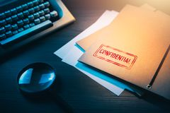 Private detective desk with envelopes labeled as confidential. Private investigator desk with confidential envelopes stock photography