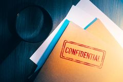 Private detective desk with envelopes labeled as confidential stock photo