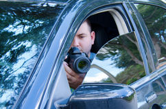Private investigator stakeout photo documentation. Private investigator on a stakeout is photographing the situation to document the events royalty free stock photo