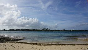 Private island bahamas. Sand water sky clouds sun view Stock Image