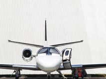 Private Jet 05. Front view private jet stationed with opened hatch Royalty Free Stock Photography