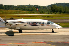 Private Jet. Landing at small airfield Stock Photography