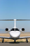 Private Jet. Private corporate jet parked at the airport against blue sky with copyspace royalty free stock images