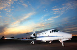 Private Jet. Portrait of a corporate jet on the runway against an evening sky Stock Photography