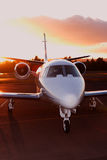 Private jet. Portrait of a corporate jet on the runway against an evening sky Royalty Free Stock Images