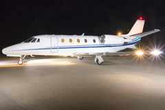 Private jet. Portrait of a corporate jet on the runway against an evening sky royalty free stock image