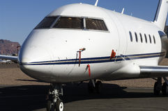 Private jet. Luxury private jet parked on the runway Stock Images