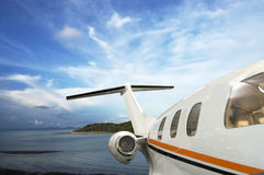 Private jet. Flying over tropical Island stock images