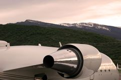 Private Jet. A private jet at a mountain airport at sunset Stock Photography