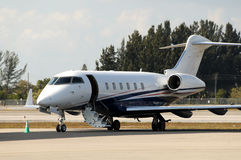 Private jet. Modern luxury private jet welcoming passengers royalty free stock images