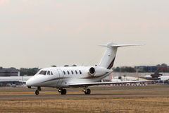 Private jet aircraft on runway. Corporate jet aircraft taxis on runway Stock Photo