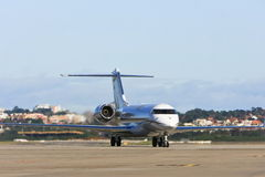 Private jet airliner on tarmac Stock Image